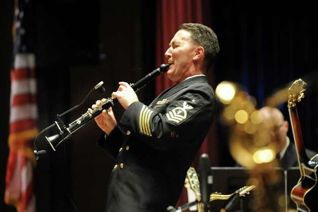 Senior Chief Musician William Mulligan of Columbus, Ohio plays a clarinet solo during the U.S. Navy Commodores Jazz Ensemble performance on Thursday, Nov. 6, 2014, at the Palace Theatre in Albany, N.Y. (Cindy Schultz / Times Union) Photo: Cindy Schultz / 00029391A