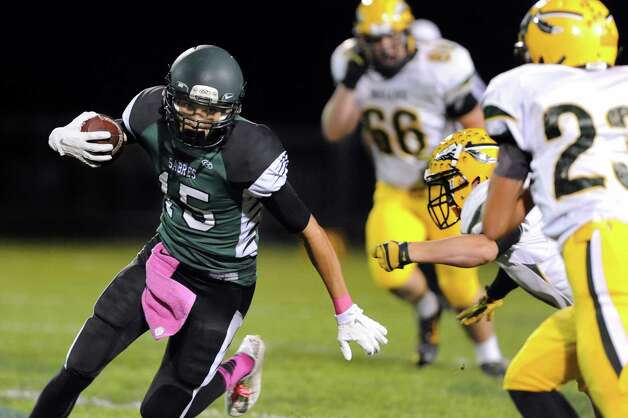 Schalmont's Devin Higgins, left, carries the ball during their football game against Ravena on Friday, Oct. 3, 2014, at Schalmont High in Rotterdam, N.Y. (Cindy Schultz / Times Union) Photo: Cindy Schultz / 00028779A