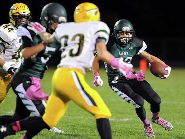 Schalmont's Hunter Gac, right, carries the ball during their football game against Ravena on Friday, Oct. 3, 2014, at Schalmont High in Rotterdam, N.Y. (Cindy Schultz / Times Union) Photo: Cindy Schultz / 00028779A