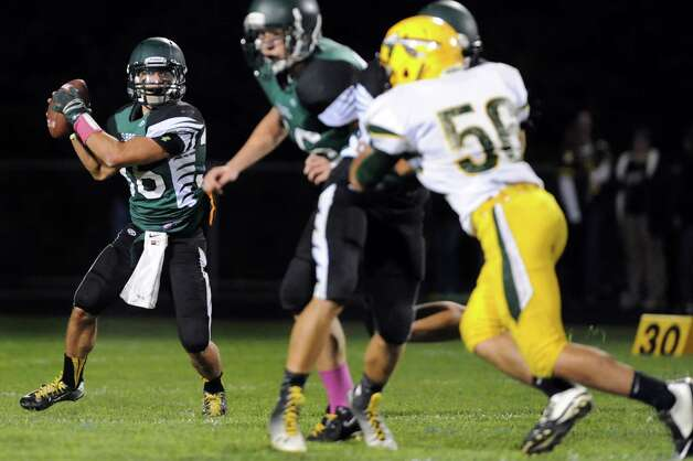 Schalmont's quarterback Nick Gallo looks for an open man during their football game against Ravena on Friday, Oct. 3, 2014, at Schalmont High in Rotterdam, N.Y. (Cindy Schultz / Times Union) Photo: Cindy Schultz / 00028779A