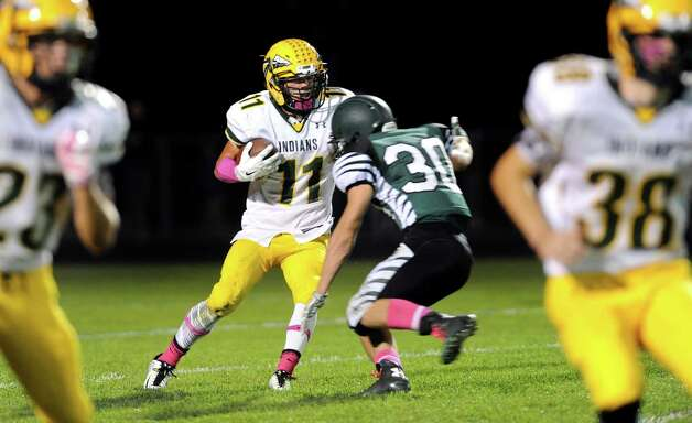 Ravena's Ian Armina, center, gains yards as Schalmont's Jack Batchler defends during their football game on Friday, Oct. 3, 2014, at Schalmont High in Rotterdam, N.Y. (Cindy Schultz / Times Union) Photo: Cindy Schultz / 00028779A