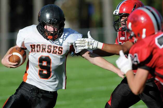 Schuylerville's Skyler Bateman, left, carries the ball during their football game against Academy on Friday, Oct. 3, 2014, at Albany Academy in Albany, N.Y. (Cindy Schultz / Times Union) Photo: Cindy Schultz / 00028780A