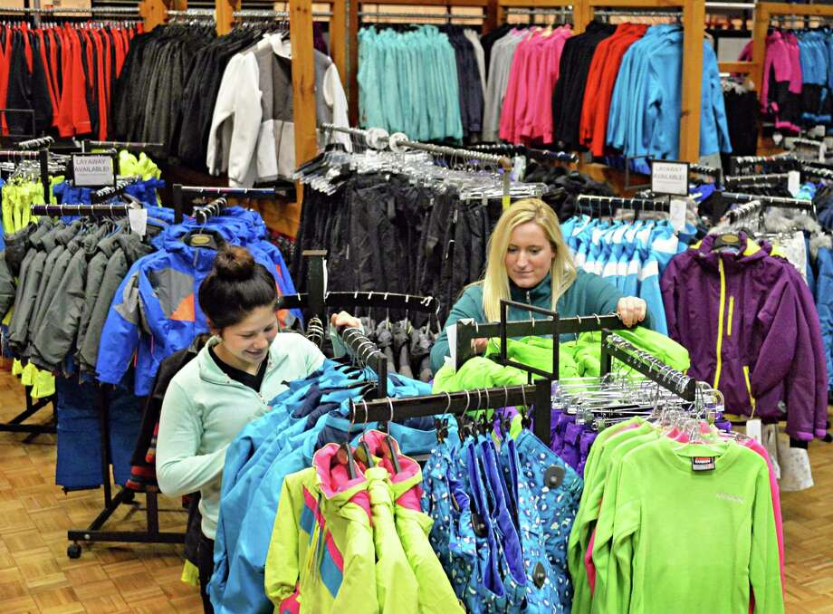 Melinda Barrett, left, and Brooke Smitherman of Alpin Haus arrange racks of winter fashions for this year's Ski & Snowboard Expo Empire State Plaza's Convention Center Thursday Nov. 6, 2014, in Albany, NY.  (John Carl D'Annibale / Times Union) Photo: John Carl D'Annibale / 00029294A