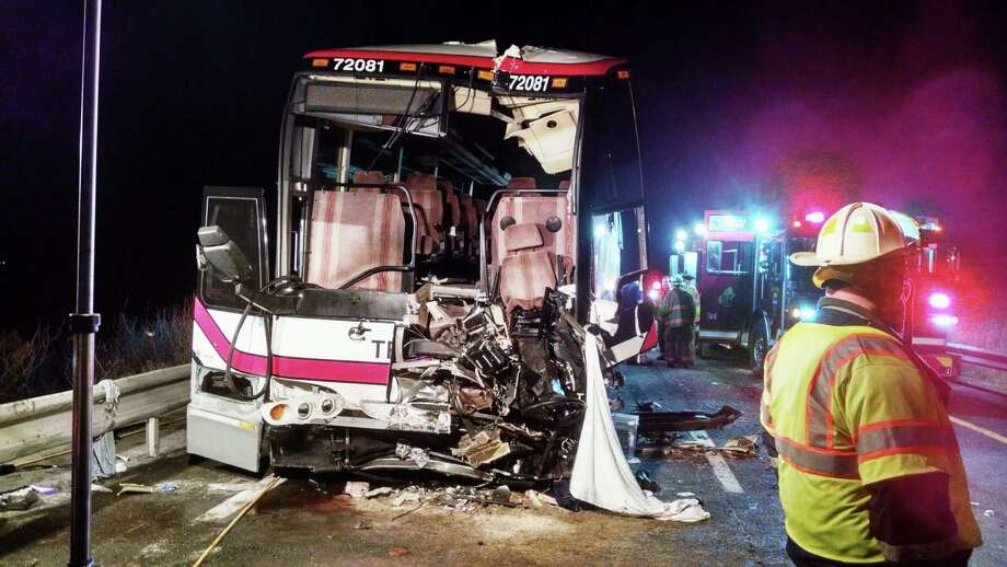 This photo provided by the Onondaga County Sheriff's Office shows the bus involved in a crash with a tractor-trailer and a car that left 27 people injured  on Interstate 81 early Thursday, Nov. 6, 2014, in Nedrow, N.Y. Twenty-six passengers suffered minor injuries on the Pine Hills Trailways bus traveling from Toronto to New York City. The bus driver is in serious condition at a Syracuse hospital. Police say the car driver has been charged with driving while intoxicated.   (AP Photo/Onondaga County Sheriff's Office) ORG XMIT: NYMG101 Photo: HOPD / Onondaga County Sheriffs Office