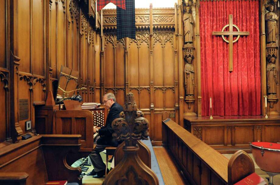 Alfred Fedak, organist and minister of music, plays the renowned 1929 Skinner pipe organ at the Westminster Presbyterian Church on Friday Oct. 31, 2014 in Albany, N.Y. The organ was restored by Dr. Thomas Older. He  and his wife, Anne, are helping to organize a fundraising concert that will ensure the continuation of a public music series featuring the Skinner organ at Westminster Presbyterian. (Michael P. Farrell/Times Union) Photo: Michael P. Farrell / 00029284A
