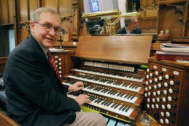 Alfred Fedak, organist and minister of music, plays the renowned 1929 Skinner pipe organ at the Westminster Presbyterian Church on Friday Oct. 31, 2014 in Albany, N.Y. The organ was restored by Dr. Thomas Older. He  and his wife, Anne, are helping to organize a fundraising concert that will ensure the continuation of a public music series featuring the Skinner organ at Westminster Presbyterian. (Michael P. Farrell/Times Union) (Michael P. Farrell/Times Union) Photo: Michael P. Farrell / 00029284A
