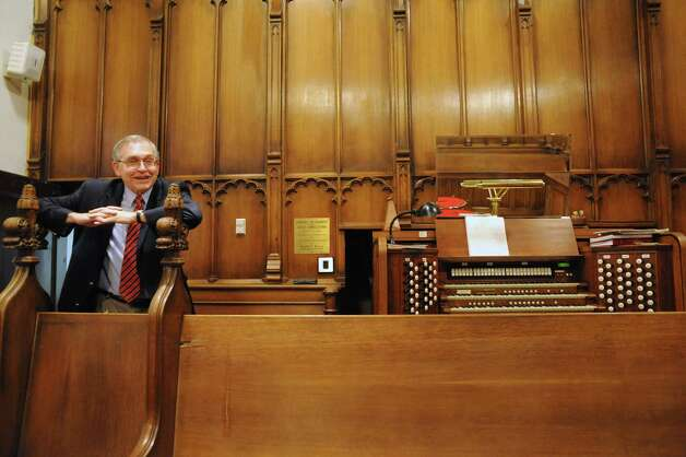 Alfred Fedak, organist and minister of music, with the renowned 1929 Skinner pipe organ at the Westminster Presbyterian Church on Friday Oct. 31, 2014 in Albany, N.Y. He  and his wife, Anne, are helping to organize a fundraising concert that will ensure the continuation of a public music series featuring the Skinner organ at Westminster Presbyterian. (Michael P. Farrell/Times Union) Photo: Michael P. Farrell / 00029284A