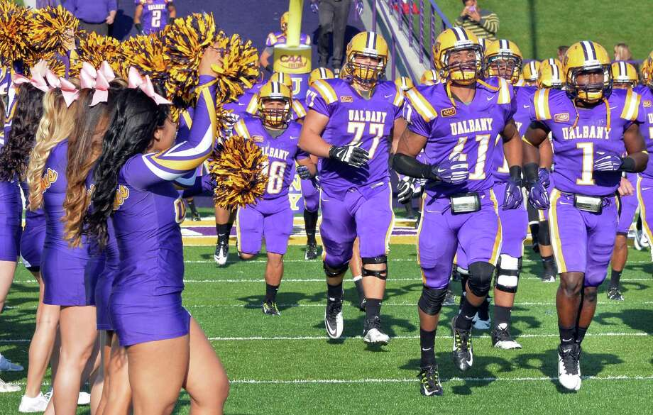 UAlbany players take the field for Saturday's game against Colgate at Bob Ford Field  Oct. 25, 2014, in Albany, NY.  (John Carl D'Annibale / Times Union) Photo: John Carl D'Annibale / 00029094A