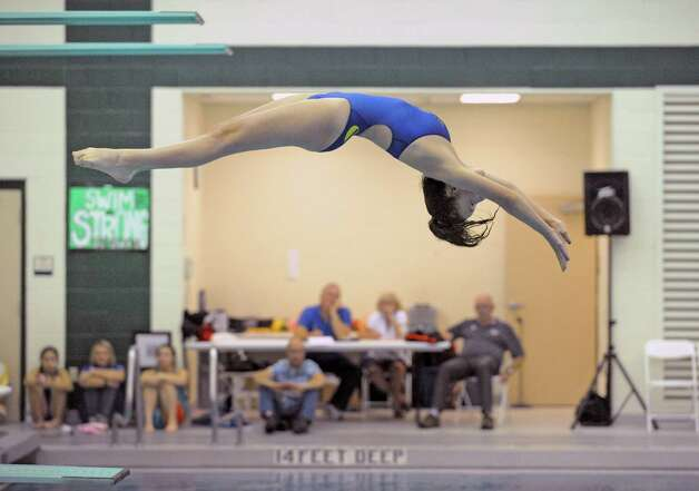 Queensbury's Lauren White makes her dive during the girl's high school Section II diving championships on Thursday Nov. 6, 2014 in Clifton Park, N.Y. (Michael P. Farrell/Times Union) Photo: Michael P. Farrell / 00029394A
