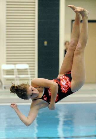 Jillian Margolies a freshman at Niskayuna High School makes her dive during the girl's high school Section II diving championships on Thursday Nov. 6, 2014 in Clifton Park, N.Y. (Michael P. Farrell/Times Union) Photo: Michael P. Farrell / 00029394A