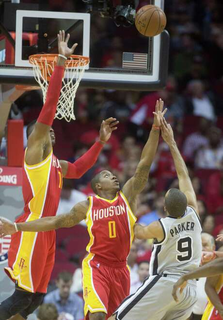 Center Dwight Howard and guard Isaiah Canaan defend against San Antonio's Tony Parker during the Rockets' blowout of the short-handed Spurs. Photo: Cody Duty, Staff / © 2014 Houston Chronicle