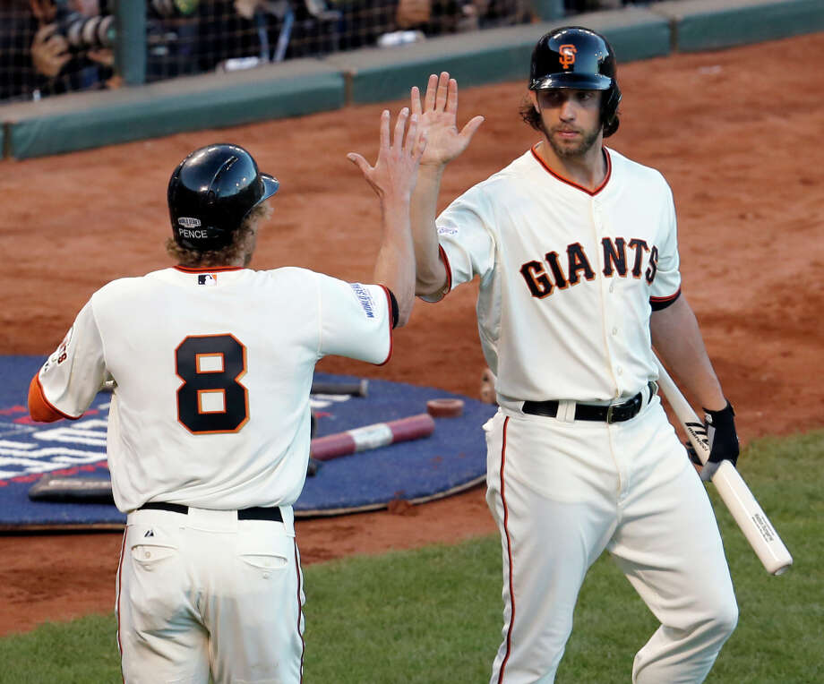 Giants pitcher Madison Bumgarner (right), dangerous with a bat in his hand, gets a high-five from Hunter Pence. Photo: Brant Ward / The Chronicle / ONLINE_YES