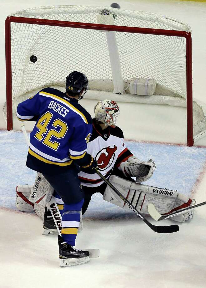 St. Louis Blues' David Backes (42) scores past New Jersey Devils goalie Keith Kinkaid during the third period of an NHL hockey game Thursday, Nov. 6, 2014, in St. Louis. The Blues won 4-3. (AP Photo/Jeff Roberson) ORG XMIT: MOJR113 Photo: Jeff Roberson / AP