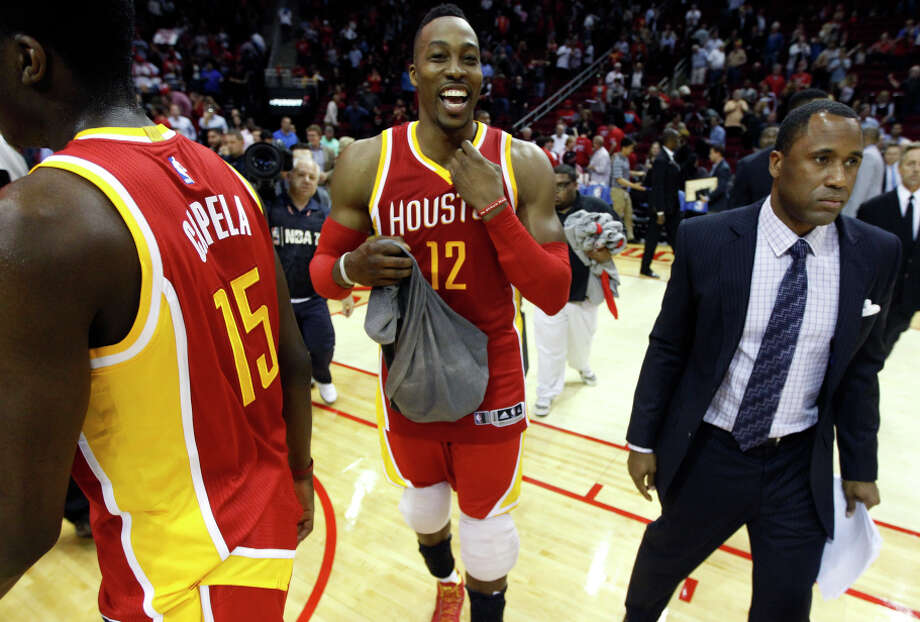 Dwight Howard (12) looks happy after posting 32 points and 16 rebounds against the defending champions sans Tim Duncan. Photo: Patric Schneider / Associated Press / FR170473 AP