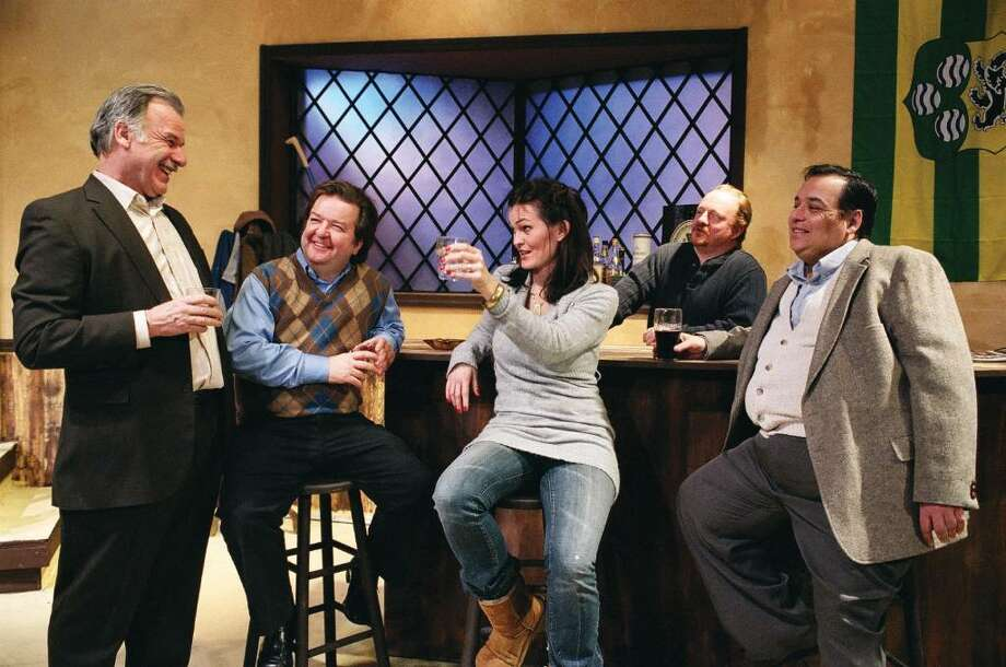 Valerie (Linda Moran Branch), the newcomer from Dublin, toasts Jack (Will Jeffries) as Jimmy (Tom Rushen), Brendan the bartender (Raymond Stephens) and Finbar (Stephen DiRocco) goodheartedly look on.  They appear in the Town Players of New Canaan's production of Conor McPherson's award winning drama THE WEIR which plays Feb. 26 to March 13 at the Powerhouse Theatre, Waveny Park, New Canaan. Photo: Contributed Photo / New Canaan News