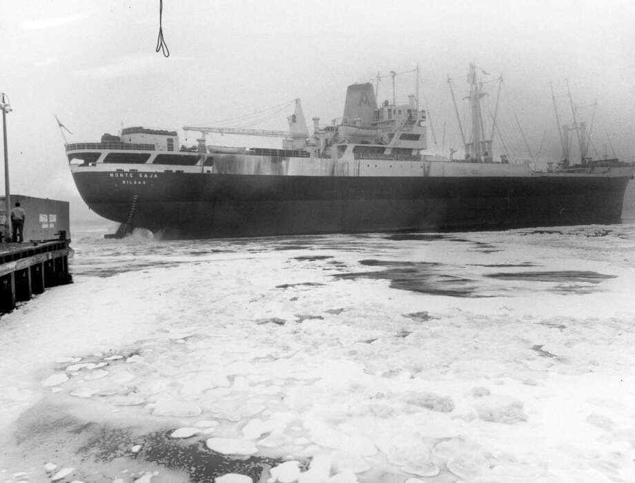 Detergents in the Houston Ship Channel give it the appearance of an icy Arctic port Monday as the cargo ship Monte Saja churns the water near Jacintoport while navigating a fog-bound passage. March 1971. Photo: Bert Brandt / Houston Chronicle