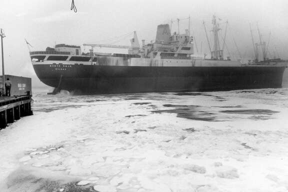 Detergents in the Houston Ship Channel give it the appearance of an icy Arctic port Monday as the cargo ship Monte Saja churns the water near Jacintoport while navigating a fog-bound passage. March 1971.