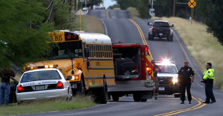Police and fire crews clear the scene of an accident involving an East Central ISD School bus Friday morning November 7, 2014 on the 12, 500 block of Southton road. None of the students on board were injured and the people in the SUV that collided with the bus were not seriously injured. Photo: John Davenport, Express-News / ©San Antonio Express-News/John Davenport