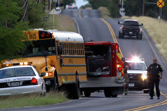 Police and fire crews clear the scene of an accident involving an East Central ISD School bus Friday morning November 7, 2014 on the 12, 500 block of Southton road. None of the students on board were injured and the people in the SUV that collided with the bus were not seriously injured.