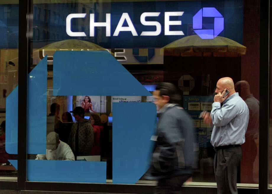 In this April 13, 2010 file photo, pedestrian traffic moves past a Chase branch in New York. JPMorgan Chase & Co. has the largest market share of banks in the Houston metropolitan area. (AP Photo/Richard Drew, File) Photo: Richard Drew, STF / AP