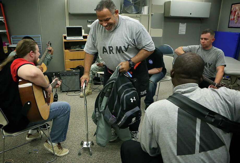 Angel Figueroa smiles as he leaves the guitar class. Photo: BOB OWEN / BOB OWEN / San Antonio Express-News / © 2014 San Antonio Express-News