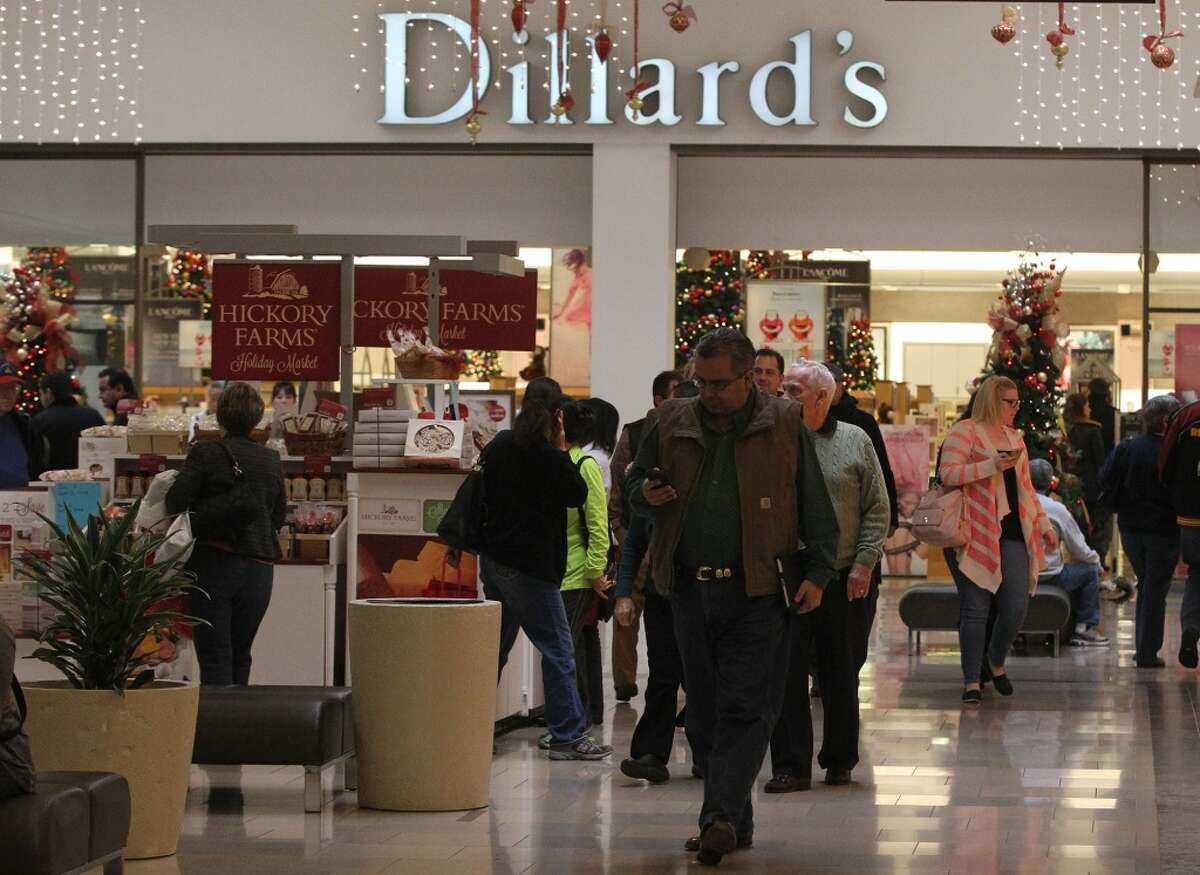 Dillard's will remain closed on Thanksgiving Day. Shoppers at North Star Mall walk near Dillard's department store Thursday December 26, 2013. Many people return Christmas gifts, use gift receipts or exchange items during the days following the Christmas holiday.