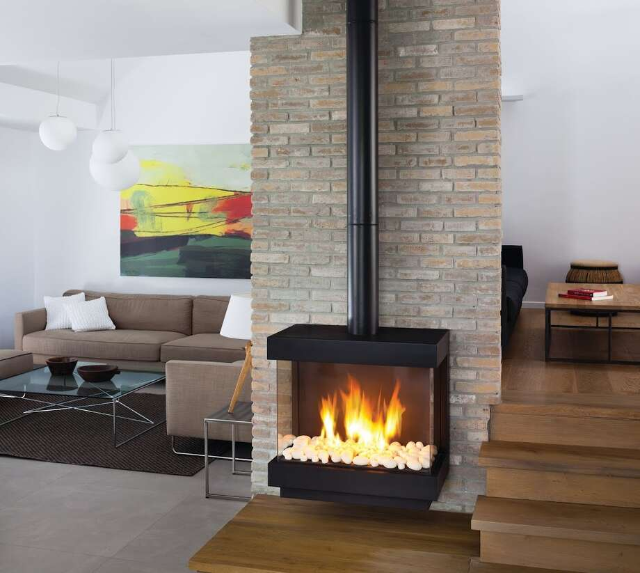 Stand-alone gas fireplaces are becoming popular options for heating homes,  and they become a focal point in the room. Photo: Courtesy Hearth,  Patio & Barbecue