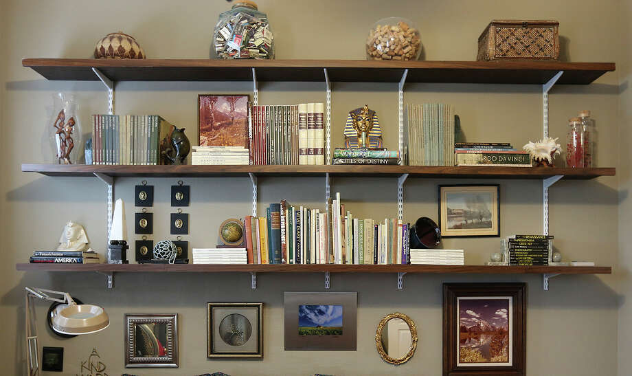 Shelves hold books and display mementos. Photo: JERRY LARA, Staff / San Antonio Express-News / © 2014 San Antonio Express-News