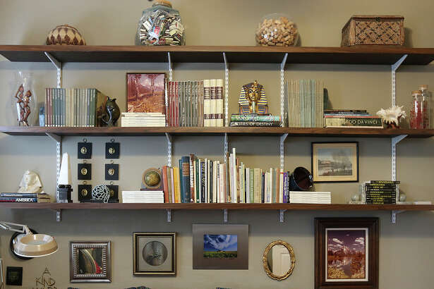 Shelves hold books and display mementos.