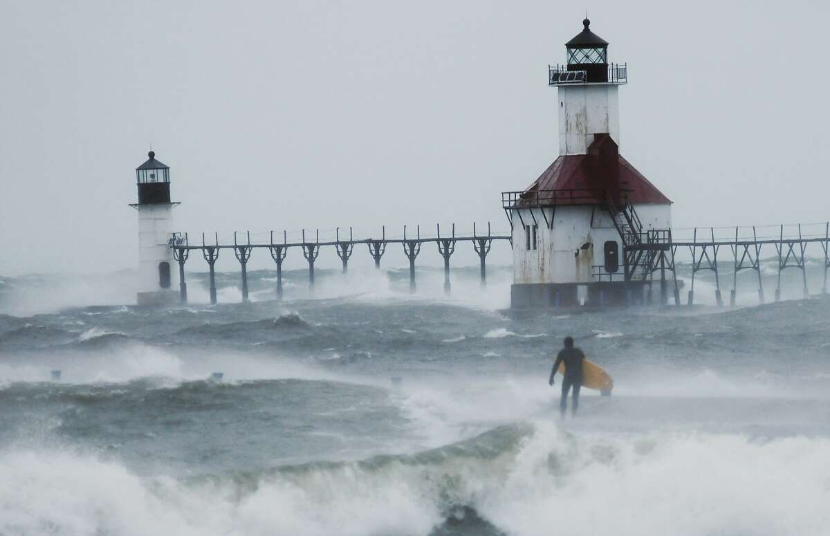 Late-season surf: A surfer checks on Lake Michigan wave conditions near the St. Joseph Lighthouses in St. Joseph, Mich. In case you're tempted, note that average lake surface temperatures are hovering around 50.