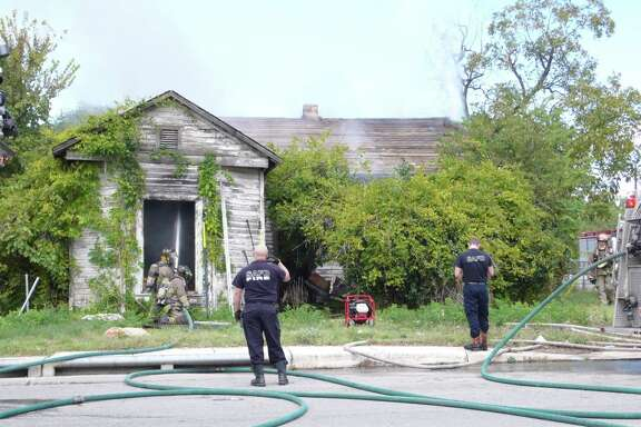 Firefighters respond to a fire at unoccupied home in the 1700 block of East Houston Street.