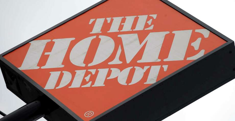 In this Tuesday, Aug. 14, 2012 photo, a Home Depot sign is shown in Nashville, Tenn. The Home Depot Inc. said Thursday, Nov. 6, 2014, that hackers stole 53 million email addresses in addition to the payment card data it previously disclosed. It says the hackers accessed its network from a third-party vendor. (AP Photo/Mark Humphrey) Photo: Mark Humphrey / Associated Press / AP