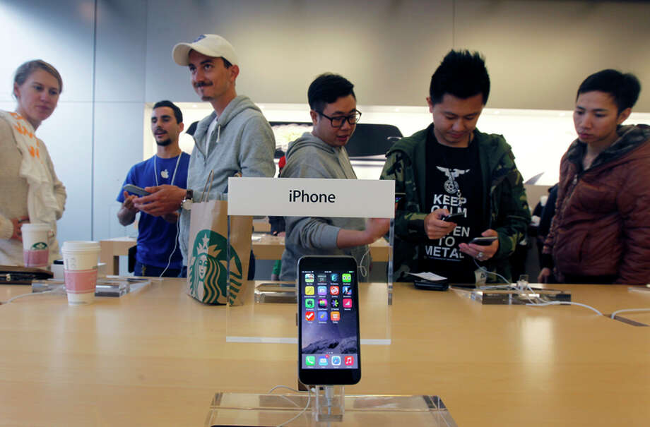 Apple devices are the most popular smartphones, making up 41 percent of the market. Photo: Paul Chinn / The Chronicle / ONLINE_YES