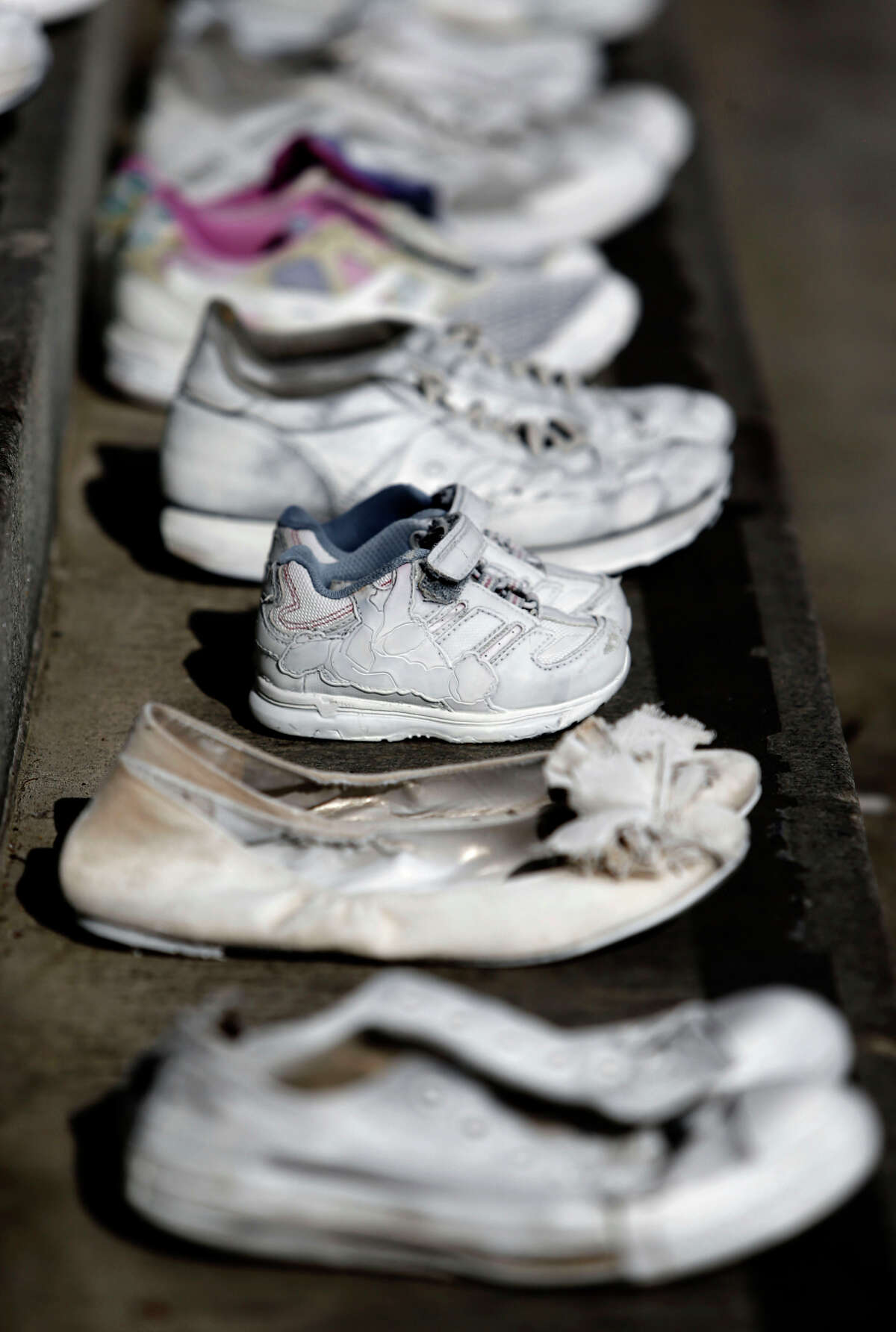 Dozens of pairs of white-painted shoes represent each person killed in a traffic collision in San Francisco this year.
