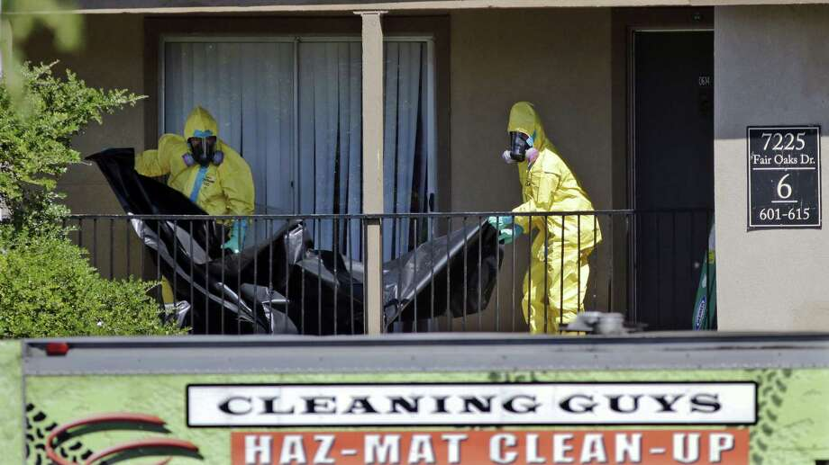 Hazardous material cleaners work outside the apartment where Thomas Eric Duncan, the Ebola patient who traveled from Liberia, stayed in Dallas. Photo: LM Otero / Associated Press / AP