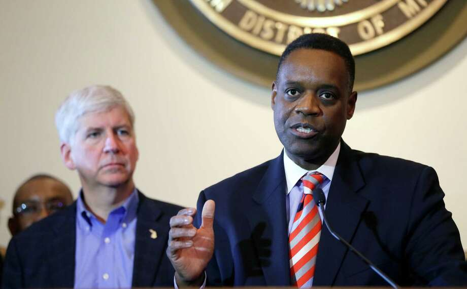 Michigan Gov. Rick Snyder, left, listens as Detroit emergency manager Kevyn Orr discusses the ruling. Photo: Carlos Osorio / Associated Press / AP