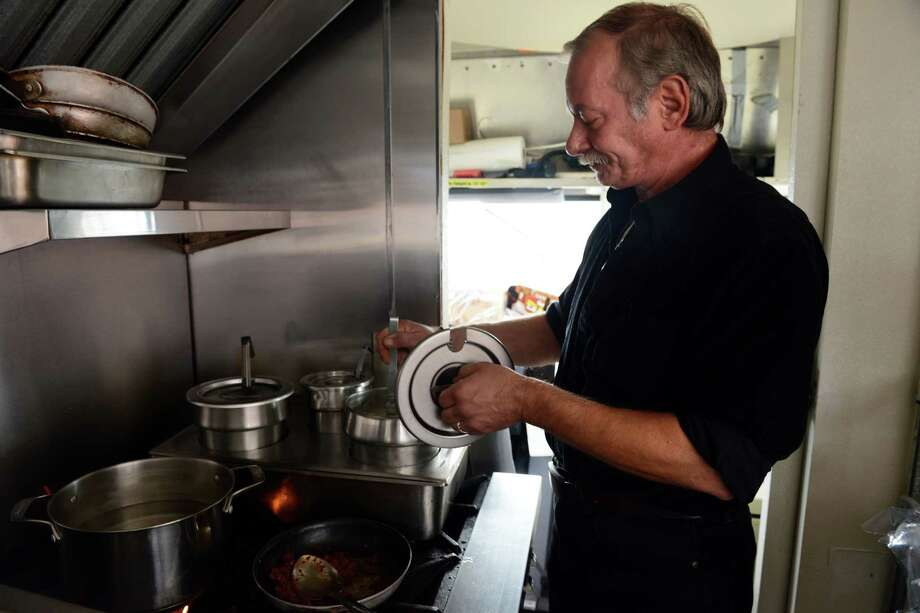Bob Costello, of Milford, stirs the clam chowder Friday, Nov. 7, 2014, at The Chowder Spot lunch truck, which has moved from the boat ramp on Birdseye Street to the Dock Shopping Center in Stratford, Conn. Photo: Autumn Driscoll / Connecticut Post