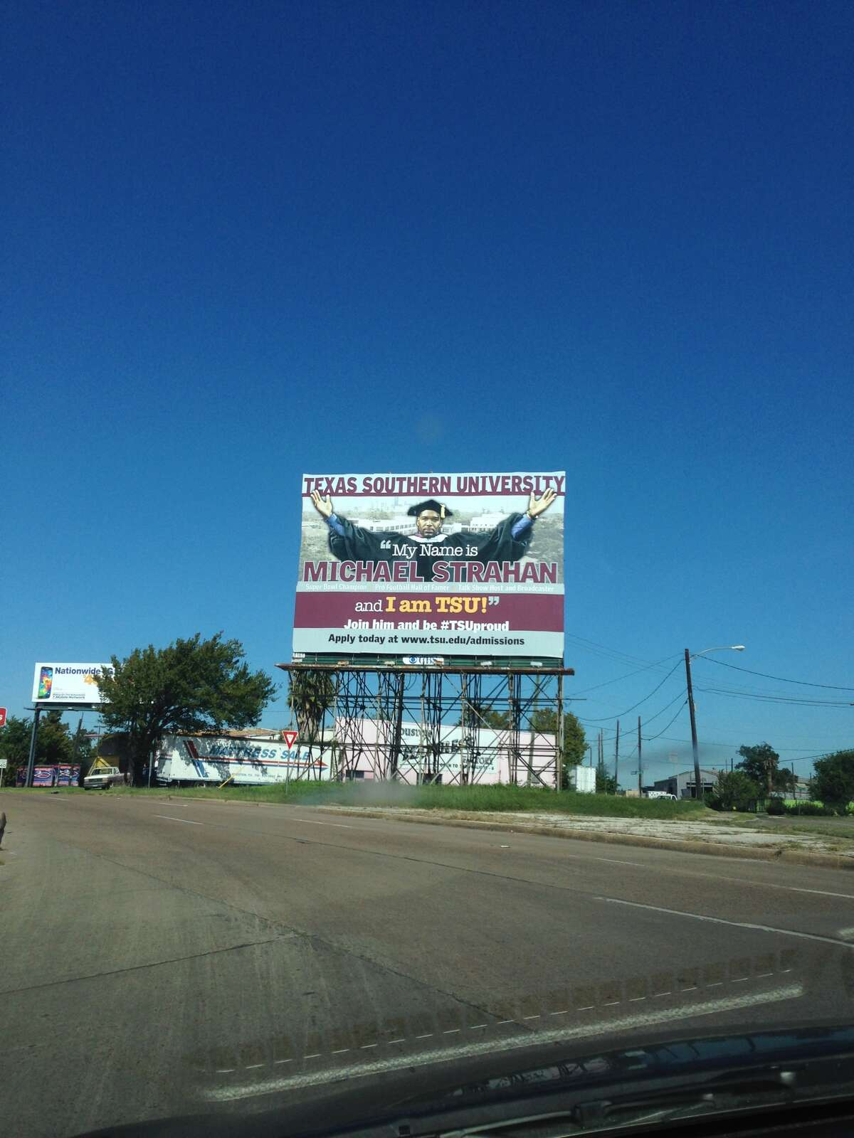 Michael Strahan, a Texas Southern University graduate and former professional football player, appears on a billboard advertising the university off Interstate 45.