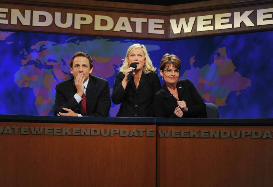 Seth Meyers, from left, Amy Poehler, and Sarah Palin ham it up during a 'Weekend Update' skit  in 2008. Photo: NBC, Contributor / 2012 NBCUniversal, Inc.