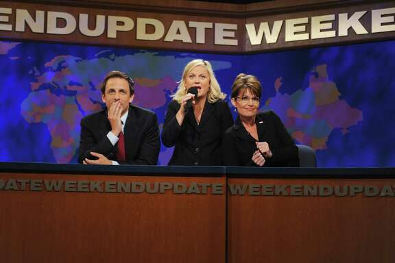 Seth Meyers, from left, Amy Poehler, and Sarah Palin ham it up during a 'Weekend Update' skit  in 2008.