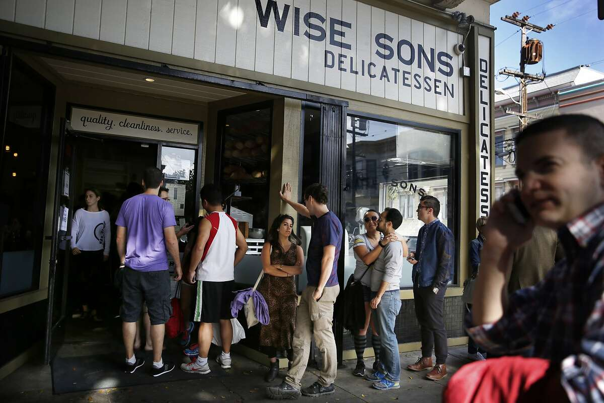 People waiting in line at Wise Son's Jewish Delicatessen trails outside the front doors and along the front of the restaurant on Saturday, October 25, 2014 in San Francisco, Calif.
