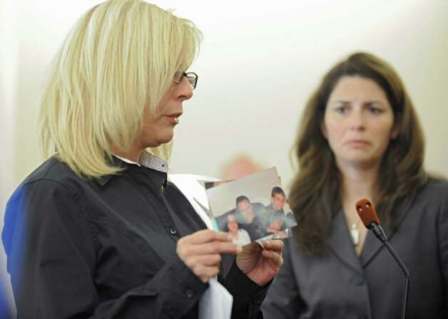 Kristina Merges, mother of the children of Paul Merges Jr, speaks and shows photographs in front of Judge Andrew Ceresia before Pablo Cruz received a sentence of 25 years to life for the second-degree murder conviction of her ex husband Paul Merges Jr. at the Albany County Judicial Center on Friday, Nov. 7, 2014 in Albany, N.Y. Cruz drunkenly plowed his pick-up truck into Merges in Albany and led police on a two-county chase with the victim's body on his vehicle that ended in Schenectady.( Lori Van Buren / Times Union) Photo: Lori Van Buren / 00029381A