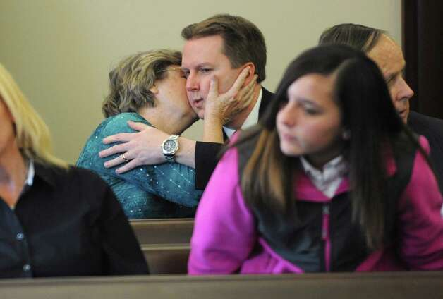 Gene Merges, brother of Paul Merges Jr. gets a kiss, from a woman who didn't want to giver her name, after Judge Andrew Ceresia sentenced Pablo Cruz to 25 years to life for the second-degree murder conviction of Paul Merges Jr. at the Albany County Judicial Center on Friday, Nov. 7, 2014 in Albany, N.Y. Cruz drunkenly plowed his pick-up truck into Merges in Albany and led police on a two-county chase with the victim's body on his vehicle that ended in Schenectady. ( Lori Van Buren / Times Union) Photo: Lori Van Buren / 00029381A