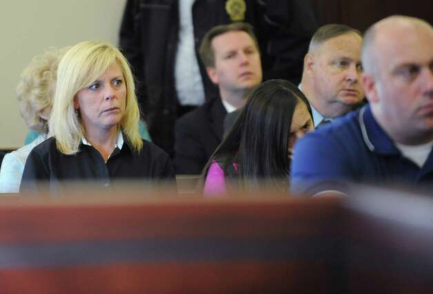 Kristina Merges, mother of the children of Paul Merges Jr, left, listens to Judge Andrew Ceresia before Pablo Cruz received a sentence of 25 years to life for the second-degree murder conviction of her ex husband Paul Merges Jr. at the Albany County Judicial Center on Friday, Nov. 7, 2014 in Albany, N.Y. Cruz drunkenly plowed his pick-up truck into Merges in Albany and led police on a two-county chase with the victim's body on his vehicle that ended in Schenectady.( Lori Van Buren / Times Union) Photo: Lori Van Buren / 00029381A