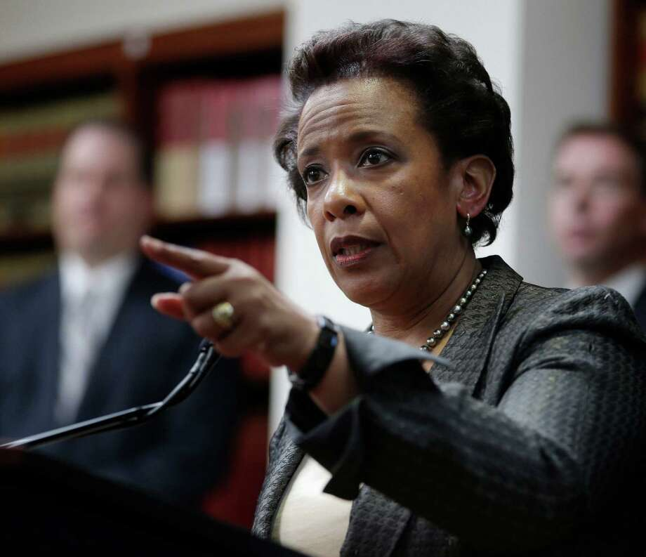 FILE- In this April 28, 2014 file photo, Loretta Lynch, U.S. Attorney for the Eastern District of New York speaks during a news conference in New York. Lynch has emerged as the leading choice to be the next attorney general, but President Barack Obama does not plan to make a nomination until after a trip to Asia next week. (AP Photo/Seth Wenig, File) Photo: Seth Wenig / Associated Press / AP