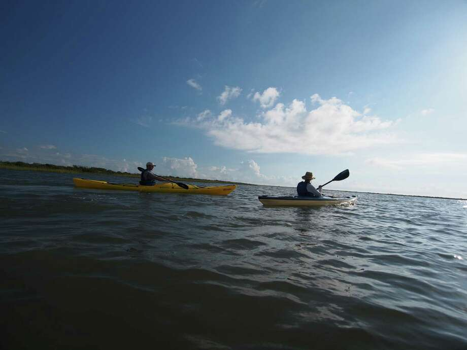 Port O'ConnorThis coastal paradise about 150 miles from Houston offers a glittering maze of waterways just waiting for a pair of kayaks. You might even see a dolphin along the way. Learn more about Matagorda Island's back bays at HoustonChronicle.com.  Photo: Chris LeBlanc, Special To The Statesman / Austin American-Statesman