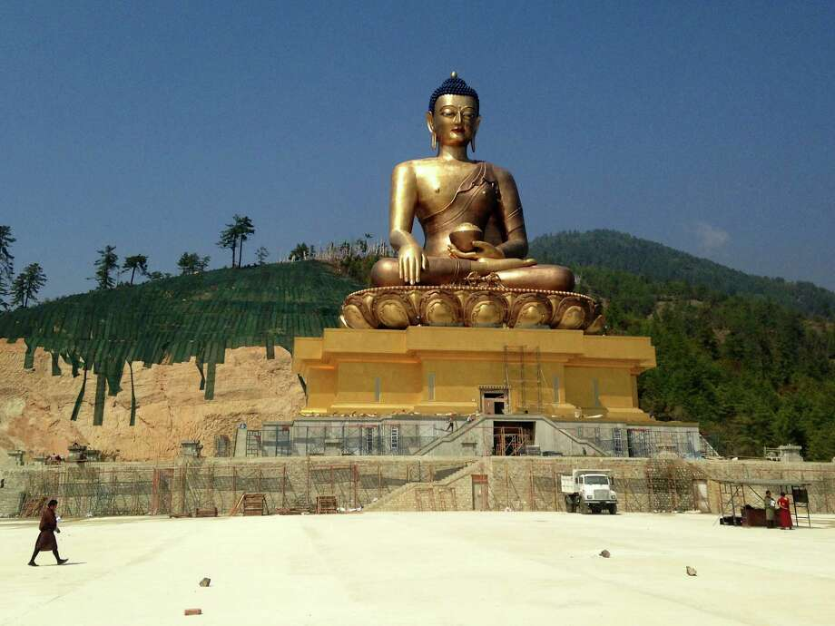 The largest Buddha statue in Bhutan, known as Kuensel Phodrang, or Buddha Point, sits on a hill above the city of Thimphu. Photo: Dan Oko