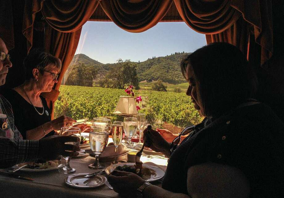 Gourmet meals are served on the Napa Valley Wine Train as it trundles past vineyards at a soothing pace. Photo: Maggie Galehouse