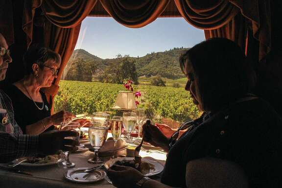 Gourmet meals are served on the Napa Valley Wine Train as it trundles past vineyards at a soothing pace.