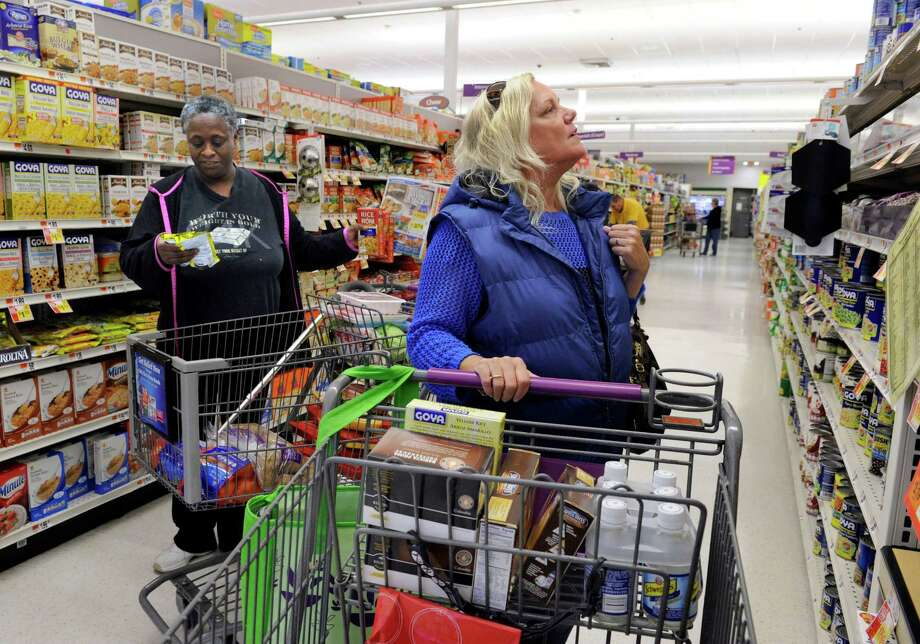 Flora Franchville, left, and Carol Levine, both of Danbury, Conn., do their grocery shopping at the Stop & Shop on Lake Ave. in Danbury, Friday, Nov. 7, 2014. Photo: Carol Kaliff / The News-Times
